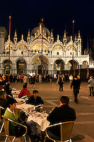 Turisti seduti di sera nei caffe' all'aperto in Piazza San Marco, a Venezia. Sullo sfondo, la Basilica.<br /> Tourists sit at outdoor cafes in St. Mark's Square, Venice, in evening light. In background, St. Mark Basilica.<br /> UPDATE IMAGES PRESS/Riccardo De Luca