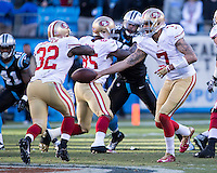 The Carolina Panthers played the San Francisco 49ers at Bank of America Stadium in Charlotte, NC in the NFC divisional playoffs on January 12, 2014.  The 49ers won 23-10.  San Francisco 49ers quarterback Colin Kaepernick (7), San Francisco 49ers running back Kendall Hunter (32)