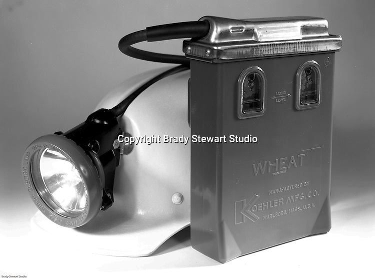 Client: Koehler Manufacturing Company<br /> Ad Agency: W.F. Minnick &amp; Associates<br /> Product: Mark II Wheat Lamp<br /> Location: Brady Stewart Studio, 725 Liberty Avenue in Pittsburgh<br /> <br /> A wheat lamp is a type of incandescent light designed for use in underground mining, named for inventor Grant Wheat.<br /> For use in hazardous areas such as firedamp and coal dust, the lamp is mounted on the front of the miner's helmet and powered by a wet cell battery worn on the miner's belt.