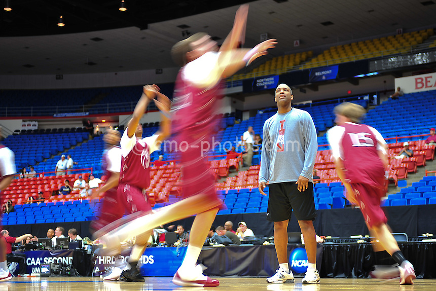 Mar 16, 2011; Tucson, AZ, USA; Slow shutter speed shot of Temple Owls assistant coach Shawn Trice runing a drill during practice the day before the second round of the 2011 NCAA men's basketball tournament at the McKale Center.