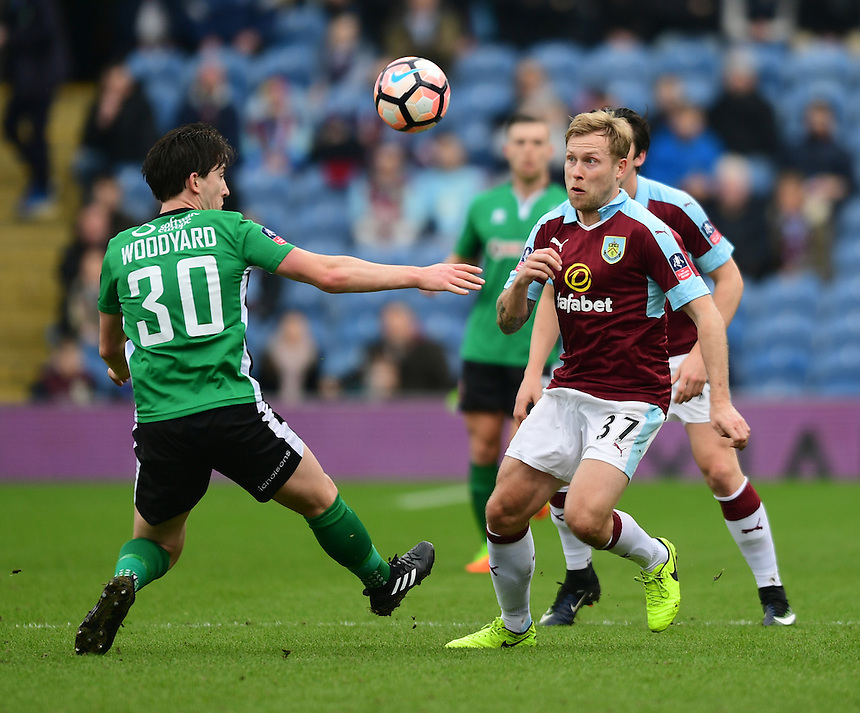 Burnley's Scott Arfield vies for possession with Lincoln City's Alex Woodyard<br /> <br /> Photographer Chris Vaughan/CameraSport<br /> <br /> Emirates FA Cup Fifth Round - Burnley v Lincoln City - Saturday 18th February 2017 - Turf Moor - Burnley <br />  <br /> World Copyright &copy; 2017 CameraSport. All rights reserved. 43 Linden Ave. Countesthorpe. Leicester. England. LE8 5PG - Tel: +44 (0) 116 277 4147 - admin@camerasport.com - www.camerasport.com