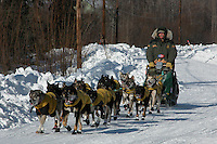 Jeff King's team arrives at Anvik in second place. Photo by Jon Little.