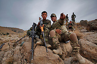 An Afghan National Army soldier and a United States Army advisor scope the mountains that overlook the border with Pakistan...International forces are increasingly relying on Afghan National Security Forces (ANSF) such as the Afghan National Army  (ANA) in conducting village searches, key village leader engagements and biometrics intelligence gathering operations in preparation for the 2013 handover of security operations to the ANSF...Members of 2nd Platoon, Comanche Company, 1-501 IN (ABN) (Task Force Blue Geronimo) out of Fort Richardson Alaska took part in a joint 4-day mission with members of the Afghan National Army in the mountains that overlook the border with Pakistan. The purpose of the mission was to survey the area for possible insurgency activity as well as to search surrounding villages for possible weapons caches.