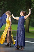 "11 July 2014, Muelheim/Ruhr, Germany. Simone Thoma as Antigone and Petra von der Beek as Ismene. Roberto Ciulli's ""Theater an der Ruhr"" perform ""Antigone"" as part of their open-air season ""Weisse Naechte"" (White Nights) in Raffelbergpark, Muelheim an der Ruhr, Germany."