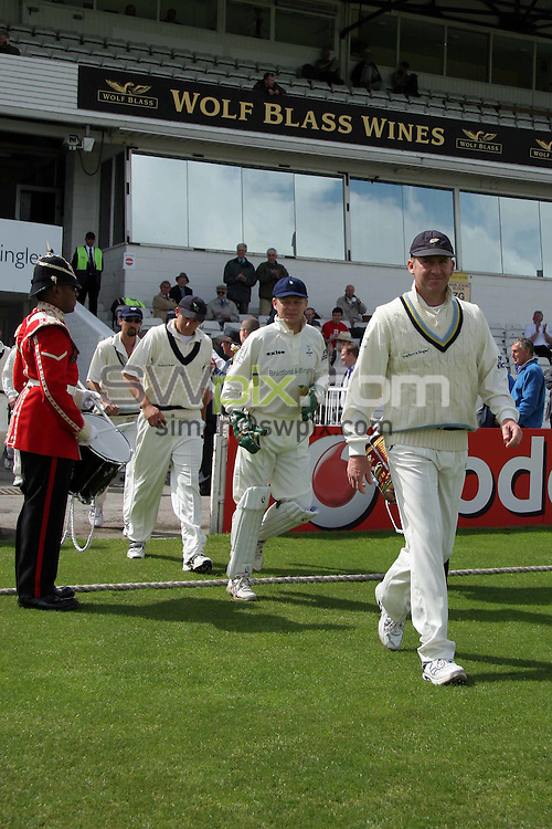 PICTURE BY VAUGHN RIDLEY/SWPIX.COM -  Cricket - Liverpool Victoria County Cricket Championship Division One - Yorkshire v Lancashire - Headingley, Leeds, England - 16/05/06...? Simon Wilkinson - 07811 267706...Yorkshire's Craig White leads his teamates out to field in the first innings of the 'War of the Roses' match versus Lancashire.