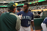 OAKLAND, CA - AUGUST 13:  Cameron Maybin #10 of the Seattle Mariners shakes hands with Oakland Athletics team photographer Michael Zagaris before their game at the Oakland Coliseum on Monday, August 13, 2018 in Oakland, California. (Photo by Brad Mangin)