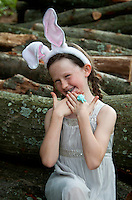 Young girl posing with Easter dress and bunny ears.