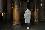 An Eritrean asylum-seeker, living in Tel Aviv, Israel, prays at the Church of Nativity in Bethlehem, West Bank, during the Coptic Christmas.