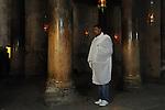 An Eritrean asylum-seeker, living in Tel Aviv, Israel, prays at the Church of Nativity in Bethlehem, West Bank, during the Coptic Christmas.