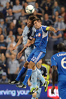 Seth Sinovic (16) defender Sporting KC goes up for a header with  Davy Arnaud (22) midfield   Montreal Impact.Sporting Kansas City defeated Montreal Impact 2-0 at Sporting Park, Kansas City, Kansas.