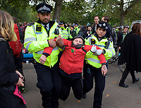 Environmental activists from Extinction Rebellion protester is dragged away by the police in London on 09 October 2019 in London, England.<br /> .<br /> Protesters plan to blockade the London government district for a two week period, as part of 'International Rebellion' taking place in over 60 cities around the world, calling for decisive and immediate action from governments in the face of climate and ecological emergency. <br /> .<br />  Photo by Alan  Stanford.