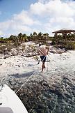 EXUMA, Bahamas. Tying off the boat at Compass Cay.