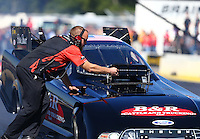 Aug 21, 2016; Brainerd, MN, USA; A crew member for NHRA funny car driver Brian Stewart during the Lucas Oil Nationals at Brainerd International Raceway. Mandatory Credit: Mark J. Rebilas-USA TODAY Sports