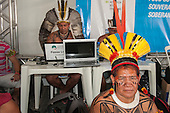 The People's Summit at the United Nations Conference on Sustainable Development (Rio+20), Rio de Janeiro, Brazil, 19th June 2012. Tabata Kuikuro looks on as more and more technology and computers are used by Indigenous Associations around the Amazon. Photo © Sue Cunningham.