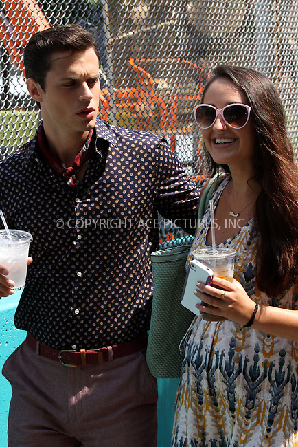WWW.ACEPIXS.COM<br /> <br /> August 20 2013, New York City<br /> <br /> Actors Jake Robinson and Katie Findlay on the Lower East Side set of the TV show 'The Carrie Diaries' on August 20 2013 in New York City<br /> <br /> By Line: Zelig Shaul/ACE Pictures<br /> <br /> <br /> ACE Pictures, Inc.<br /> tel: 646 769 0430<br /> Email: info@acepixs.com<br /> www.acepixs.com