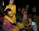SREY BREY VILLAGE, CAMBODIA-- Eng Chan, 23, an Imam San Cham bride, is covered in yellow paste to color her skin, one of many rituals over three days in a traditional Cham wedding.  PHOTO BY JODI HILTON