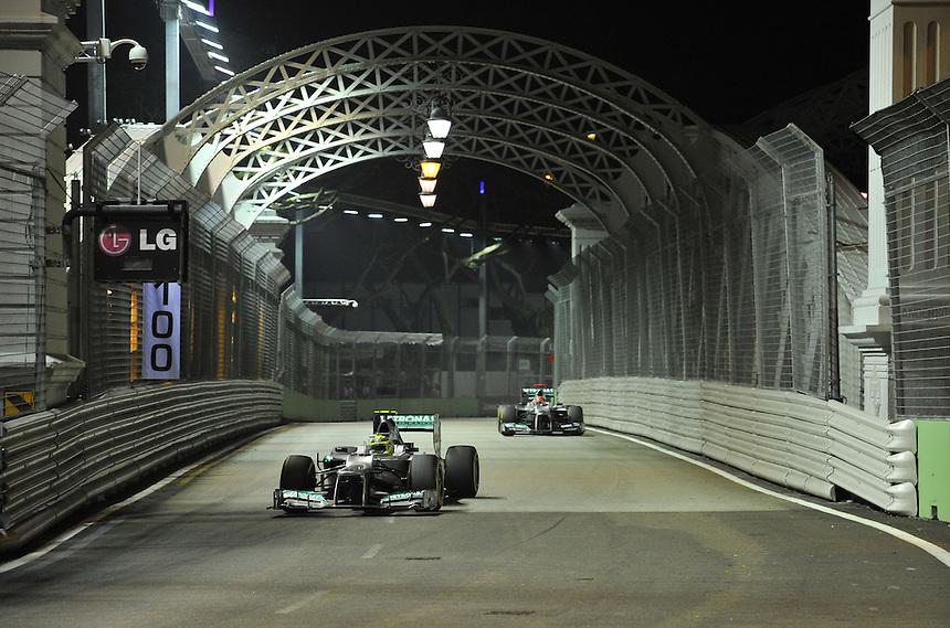 .Nico Rosberg (GER), Mercedes GP - Michael Schumacher (GER), Mercedes GP ..2012 FIA Formula One World Championship - Singtel Formula One Grand Prix, Marina Bay Street Circuit, Singapore, Singapore, Friday 21st September 2012...