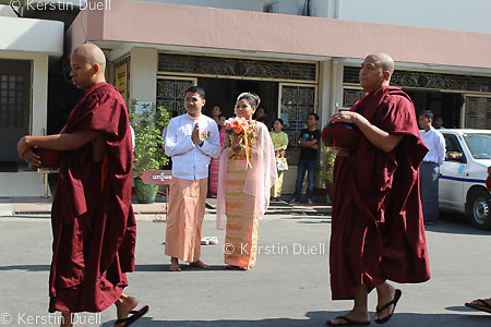 Daily routine in the Mahasi Sasana Yeiktha centre: Procession to lunch attended by a Burmese bridge & groom - lay donors tend to sponsor meals on special occasions such as weddings