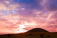 sunrise over volcanic cinder cone, Parker Ranch, Waimea, Big Island, Hawaii, USA
