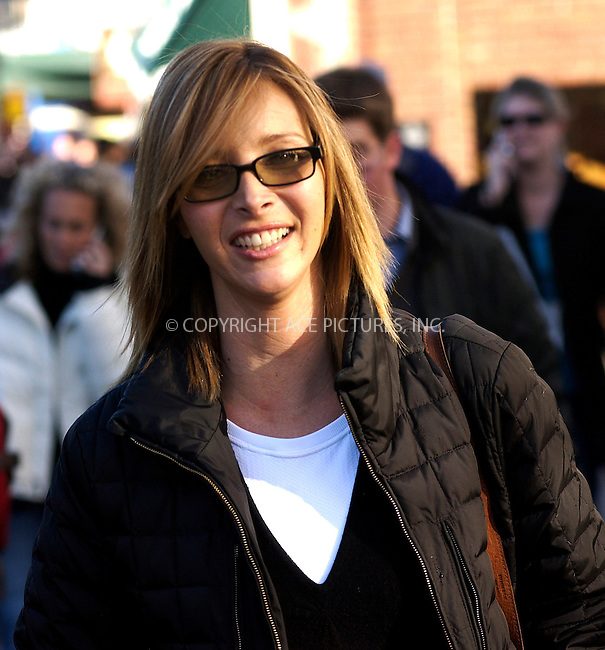 "WWW.ACEPIXS.COM . . . . .  ....PARK CITY, UTAH, JANUARY 21, 2005....Lisa Kudrow walks down Main St. to get her picture taken with other cast members of the movie ""Happy Endings"" at the Getty Images and Entertainment Weekly Magazine Studios at the Sundance Film Festival. ....Please byline: Ian Wingfield - ACE PICTURES..... *** ***..Ace Pictures, Inc:  ..Alecsey Boldeskul (646) 267-6913 ..Philip Vaughan (646) 769-0430..e-mail: info@acepixs.com..web: http://www.acepixs.com"