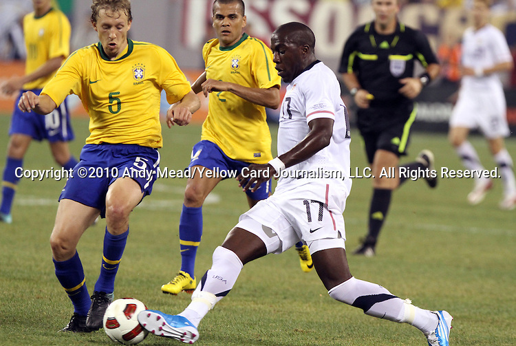 10 AUG 2010: Jozy Altidore (USA) (17) is defended by Lucas (BRA) (5) and Dani Alves (BRA) (2). The United States Men's National Team lost to the Brazil Men's National Team 0-2 at New Meadowlands Stadium in East Rutherford, New Jersey in an international friendly soccer match.