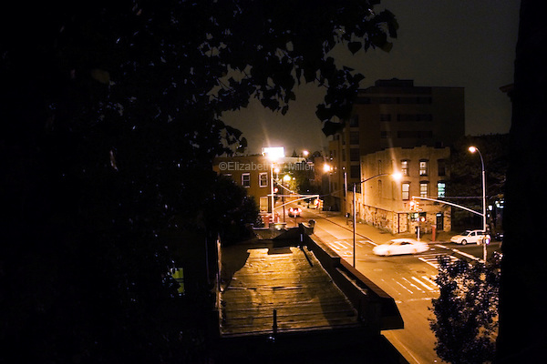 The intersection of Court Street and W. 9th Street at night.