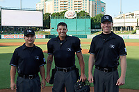 Umpires Isaias Barba, Justin Robinson, and Andy Stukel before a Texas League game between the Springfield Cardinals and Frisco RoughRiders on May 4, 2019 at Dr Pepper Ballpark in Frisco, Texas.  (Mike Augustin/Four Seam Images)