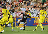 Andy Najar #14 of D.C. United  cuts between Shaun Francis #29 and Brian Carroll #16 of the Columbus Crew during an MLS match at RFK Stadium on September 4 2010, in Washington DC. Columbus won 1-0.