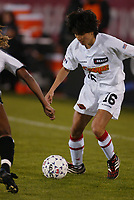 Zhao Lihong of the Philadelphia Charge attempts to beat her NY Power defender at the Power's home opener at Mitchell Athletic Complex. The Power lost 2-1.