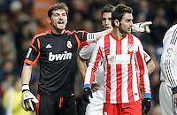 Real Madrid's Iker Casillas  reacts close to Atletico de Madrid's Adrian Lopez during La Liga Match. December 02, 2012. (ALTERPHOTOS/Alvaro Hernandez)