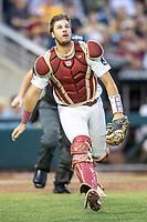 Florida State Seminoles catcher Nelson Matheu (63) attempts to catch a pop up against the Michigan Wolverines in Game 6 of the NCAA College World Series on June 17, 2019 at TD Ameritrade Park in Omaha, Nebraska. Michigan defeated Florida State 2-0. (Andrew Woolley/Four Seam Images)
