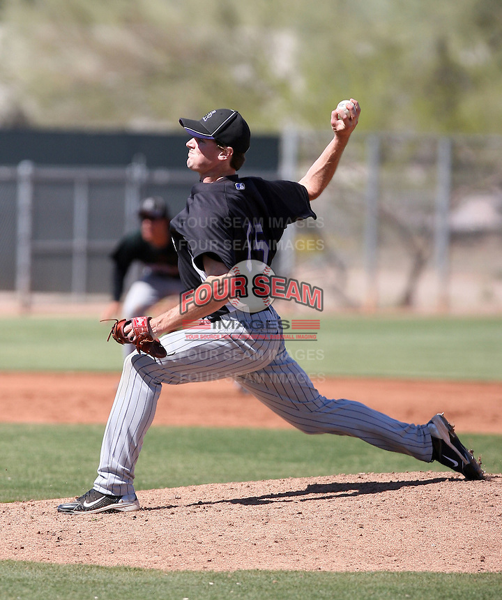 Stephen Dodson #65 of the Colorado Rockies pitches in a minor league spring training game against the San Francisco Giants at the Giants minor league complex on March 30, 2011  in Scottsdale, Arizona. .Photo by:  Bill Mitchell/Four Seam Images.