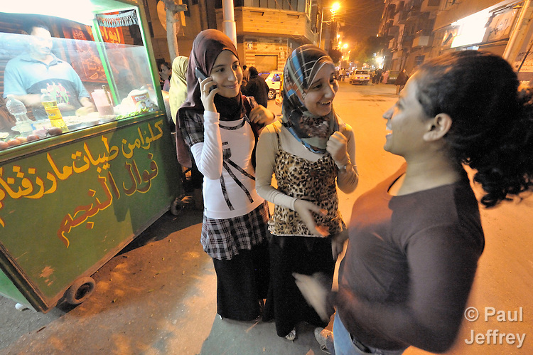 As Muslims prepare to end the holy month of Ramadan and celebrate the festival of Eid al-Fitr, which began the night of September 30, Egyptians took to the streets of their towns and cities in the evenings to shop for gifts and foods with which to celebrate the annual holiday. Here young women greet each other on the streets of the Nile River city of Minia.