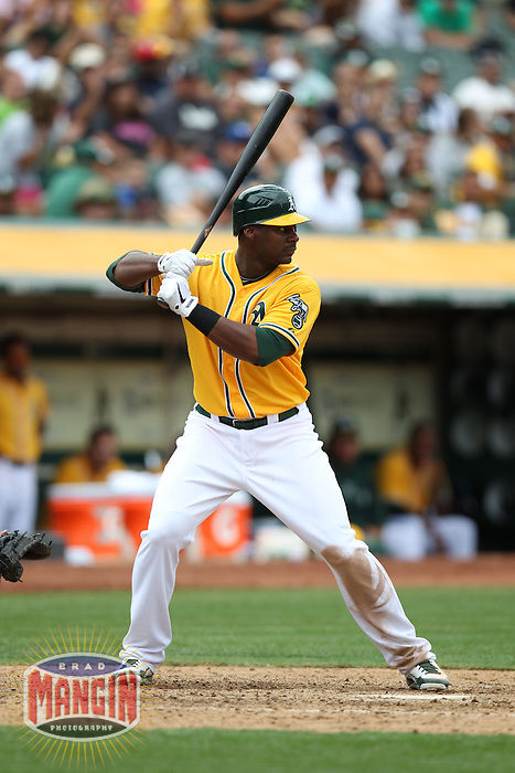 OAKLAND, CA - AUGUST 4:  Chris Carter #22 of the Oakland Athletics bats against the Toronto Blue Jays during the game at O.co Coliseum on Saturday, August 4, 2012 in Oakland, California. Photo by Brad Mangin