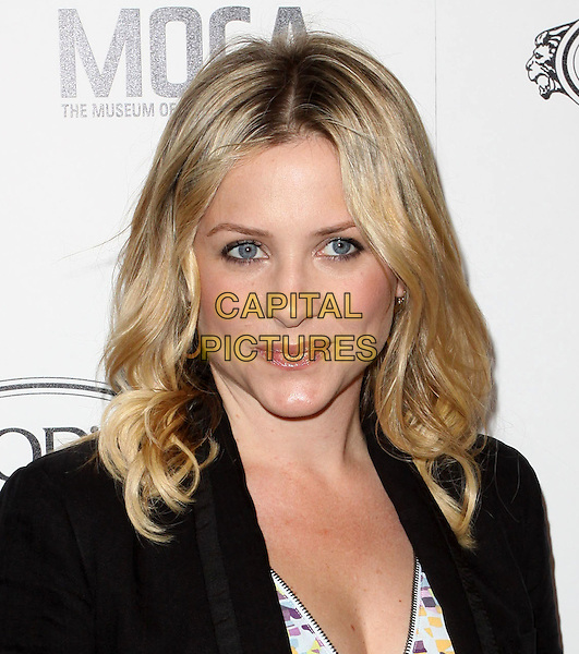 JESSICA CAPSHAW.Tod's Beverly Hills boutique Grand Opening held At Tod's Boutique, Beverly Hills, California, USA. .April 15th, 2010 .headshot portrait wavy hair make-up black .CAP/ADM/KB.©Kevan Brooks/AdMedia/Capital Pictures.