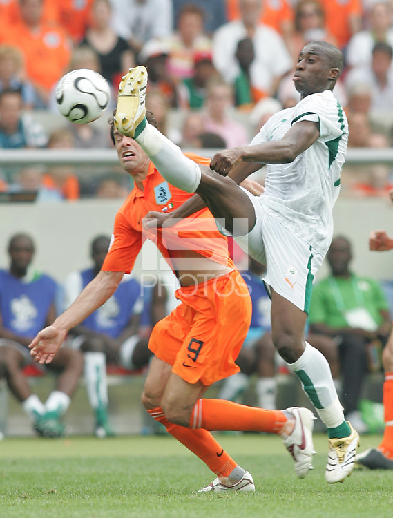 Dutch forward (9) Ruud Van Nistelrooij has the ball cleared away from him by Cote d'Ivorie defender (12) Abdoulaye Meite. Netherlands defeated Côte d'Ivoire 2-1 in their FIFA World Cup Group C match at Gottlieb-Daimler-Stadion, Stuttgart, Germany, June 16, 2006.