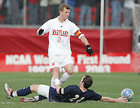 DEC 3, 2005: College Park MD, USA: Maryland Terrapins midfielder (2) Michael Dello-Russo makes his way past Akron Zips midfielder (24) Yohann Mauger at Ludwig Field. Mandatory Credit: Photo By Brad Smith-International Sports Images (c) Copyright 2005 Brad Smith