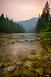 Idaho, North Central, Powell. The Lochsa River and smoky skieas at sunset in summer.