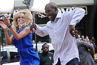 May 23, 2012 Donald Driver and Peta Murgatroyd of Dancing with the Stars at Good Morning America at Times Square in New York City. Credit: Roger Wong/MediaPunch Inc.