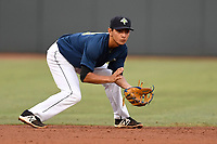 Shortstop Andres Gimenez (13) of the Columbia Fireflies plays defense in a game against the Charleston RiverDogs on Monday, August 7, 2017, at Spirit Communications Park in Columbia, South Carolina. Columbia won, 6-4. (Tom Priddy/Four Seam Images)