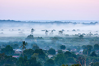 Early morning view over Bekopaka village covered in mist and smoke