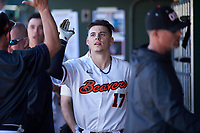 Oregon State Beavers Troy Claunch (17) is congratulated by teammates after hitting a home run during an NCAA game against the New Mexico Lobos at Surprise Stadium on February 14, 2020 in Surprise, Arizona. (Zachary Lucy / Four Seam Images)