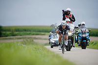 Guillaume Van Keirsbulck (BEL/OmegaPharma-Quickstep) escapes from the lead group with about 30km to go. <br /> He will gradually build his lead and solo to the biggest win in his career to date.<br /> <br /> Eneco Tour 2014<br /> stage 7: Riemst (BEL) - Sittard-Geleen (NLD) <br /> 183km