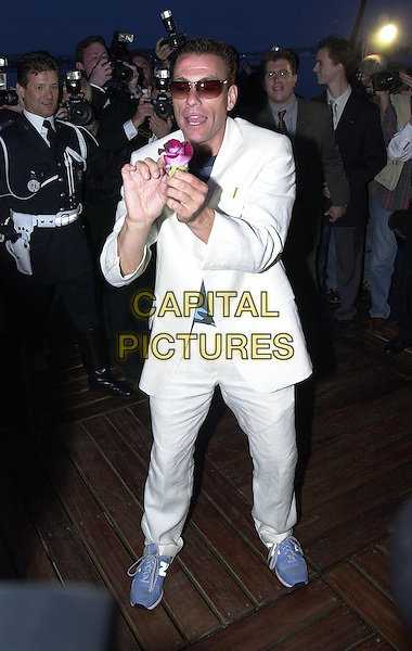 "JEAN CLAUDE VAN DAMME.Arriving at Noga Hilton pier, after a very brief photocall he left on a police motorbike.Promoting film""The Monk"".Cannes Film Festival, France,.14th May 2001..full length white suit funny gesture .Ref: PL.www.capitalpictures.com.sales@capitalpictures.com.©Capital Pictures."