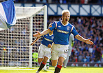 Steven Naismith scores his second and Rangers' fourth goal of the match and celebrates