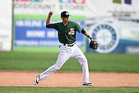 Clinton LumberKings shortstop Luis Caballero (10) throws to first during a game against the Beloit Snappers on August 17, 2014 at Ashford University Field in Clinton, Iowa.  Clinton defeated Beloit 4-3.  (Mike Janes/Four Seam Images)