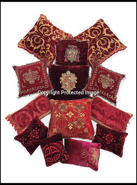 BNPS.co.uk (01202 558833)<br /> Pic: Christie's/BNPS<br /> <br /> ***Please use full byline***<br /> <br /> A group of thirteen crimson velvet cushions.<br /> <br /> An interior designer to the stars is selling virtually the entire contents of her multi-million pounds London apartment that she is moving out of.<br /> <br /> Tessa Kennedy's client list for home makeovers has included Elizabeth Taylor, George Harrison and Pierce Brosnan as well as famous hotels like the Ritz and Claridges.<br /> <br /> During her jet-set career, she acquired opulent pieces of furniture, art work and ornaments from around the world that she filled her town and country residence with.<br /> <br /> Now aged 75, Miss Kennedy no longer requires her three-bed Knightsbridge flat and is auctioning off most of its contents in a unique sale at Christie's.