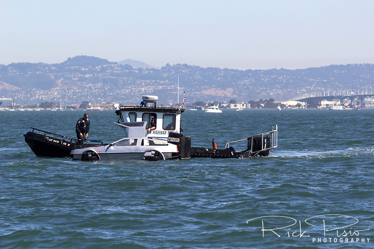 California Highway Patrol pulls over a Delorean on San Francisco Bay.