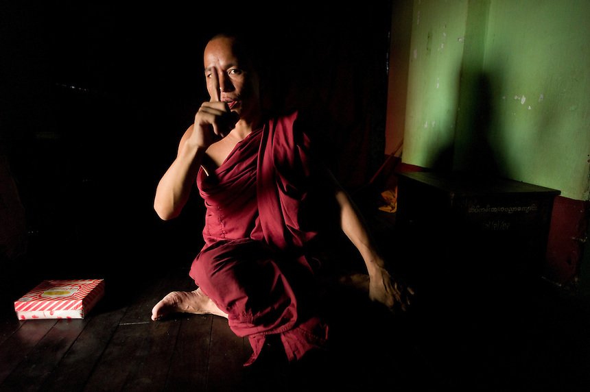 A Buddhist monk Wan Na Sharmi explains his life at the tiny Warso monastery in Yangon, Union of Myanmar (Burma). More than 50,000 Buddhist monasteries fill Myanmar, drawing monks to study from all of south and southeast Asia.