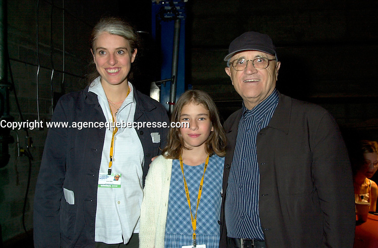 August 29,  2002, Montreal, Quebec, Canada<br /> <br /> Henriette Confurius, 11year old actress (L)<br /> Anne Wild, Film Maker (M) and<br /> Serge Losique, Montreal World Film Festival President (R)<br /> meet backstage , before the screening of Wild's movie<br /> MEIN ERSTES WUNDER (My First Miracle), presented in the official competitionof the 26th World Film Festival, August 29, 2002<br /> Born in Offenburg, Germany in 1967, Anne Wild studied literature, philosophy and art history at the University of Freiburg and acting at the Academy of Music and Applied Arts in Stuttgart. In the mid-1990s she worked in advertising in Hamburg and Berlin, then studied screenwriting and directing. Since 1997 she has worked as a freelance journalist for newspapers, radio and television. She wrote the script for WAS TUN, WENN'S BRENNT? (2002) and directed Afternoon in Siedlisko (2000) and Ballett ist ausgefallen (2001). MY FIRST MIRACLE marks her directorial debut in features. <br /> , LUCIE AUBRAC (Claude Berri, 1997), THE COMEDIAN HARMONISTS (Joseph Vilsmaier, 1997), and two by Tom Tykwer, WINTERSLEEPERS (1997) and RUN, LOLA, RUN (1998). He starred in Roland Suso Richter's hit film THE TUNNEL (2001), winner of the audience award at last year's Montreal World Film Festival, and his most recent film, THE SEAGULL'S LAUGHTER, is also showing at this year's Festival. He represents the new wave of german actors. <br /> <br /> <br /> Mandatory Credit: Photo by Pierre Roussel- Images Distribution. (&copy;) Copyright 2002 by Pierre Roussel <br /> <br /> NOTE : <br />  Nikon D-1 jpeg opened with Qimage icc profile, saved in Adobe 1998 RGB<br /> .Uncompressed  Uncropped  Original  size  file availble on request.
